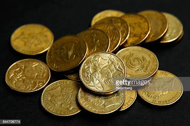 Australian onedollar coins are arranged for a photograph in Sydney Australia on Monday July 4 2016 Australia's failure to make a decisive political...