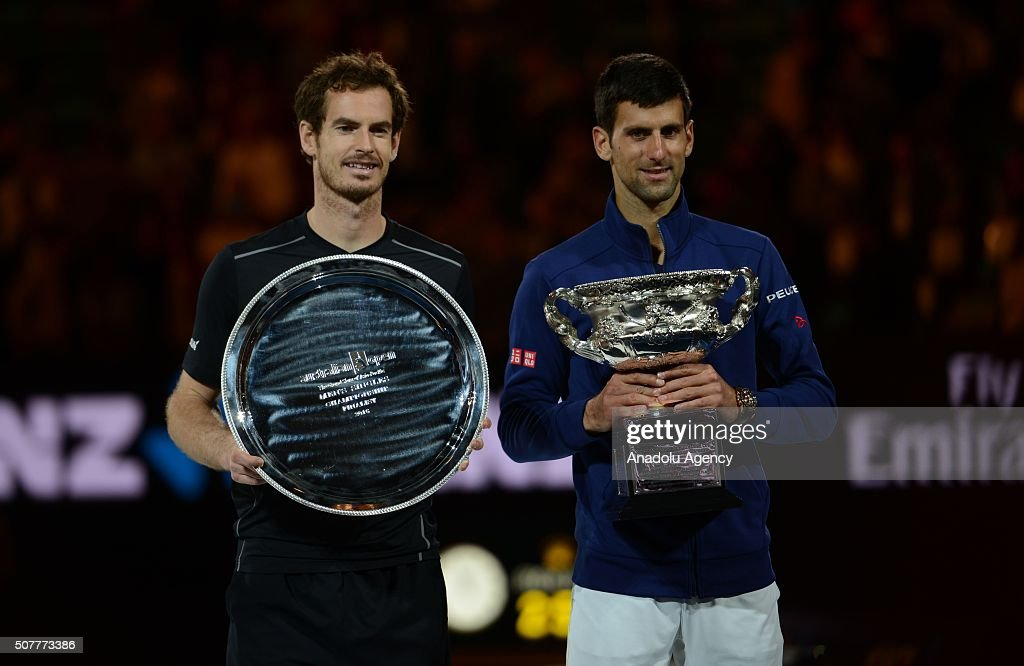 Australian Open 2016 champion Novak Djokovic of Serbia and Andy Murray (L) of England pose for a photograph after the Men's Singles Final during day 14 of the 2016 Australian Open at Melbourne Park on January 31, 2016 in Melbourne, Australia.