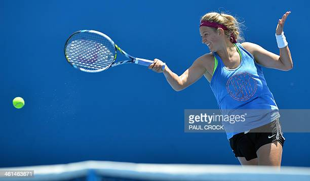 Australian Open Champion Victoria Azarenka plays a return during a practice session for the upcoming Australian Open tennis tournament in Melbourne...