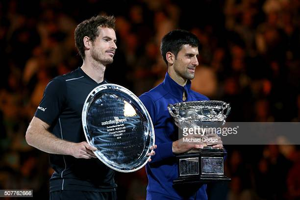 Australian Open runnerup Andy Murray of Great Britain stands beside winner Novak Djokovic of Serbia who holds the Norman Brookes Challenge Cup after...