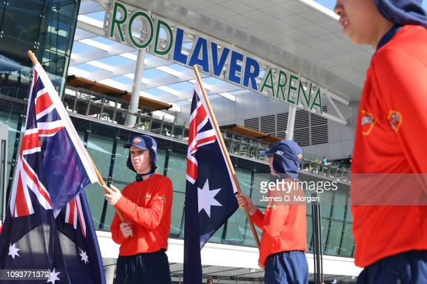 Australian Open tennis ball kids hold flags during a ceremony to open day one of the 2019 Australian Open at Melbourne Park on January 14, 2019 in...