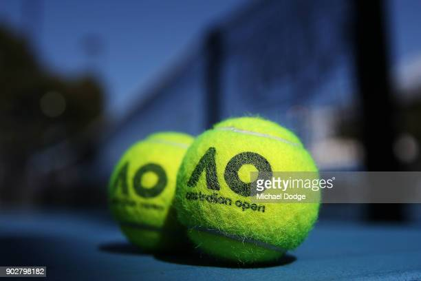 Australian Open tennisn balls are seen during a practice session ahead of the 2018 Australian Open at Melbourne Park on January 9 2018 in Melbourne...