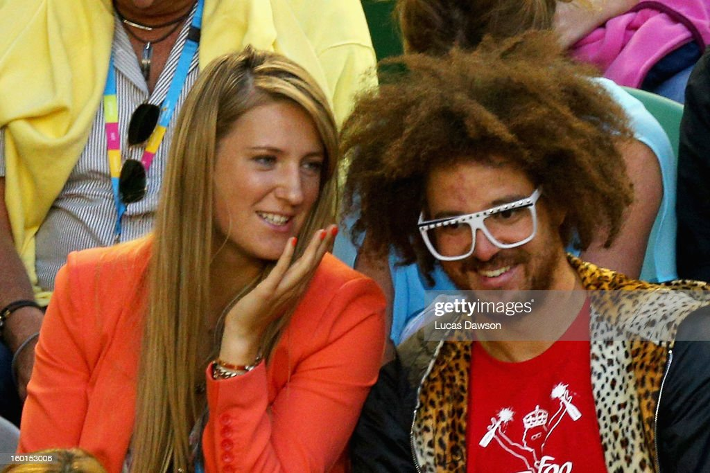 Australian Open women's champion Victoria Azarenka and Stefan Gordy aka Redfoo watch the mens final between Andy Murray of Great Britain and Novak Djokovic of Serbia during day fourteen of the 2013 Australian Open at Melbourne Park on January 27, 2013 in Melbourne, Australia.