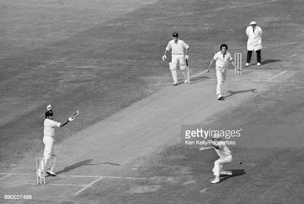 Australian opening batsman Alan Turner plays a shot past England fielder Bob Woolmer off the bowling of John Snow during the 2nd Test match between...