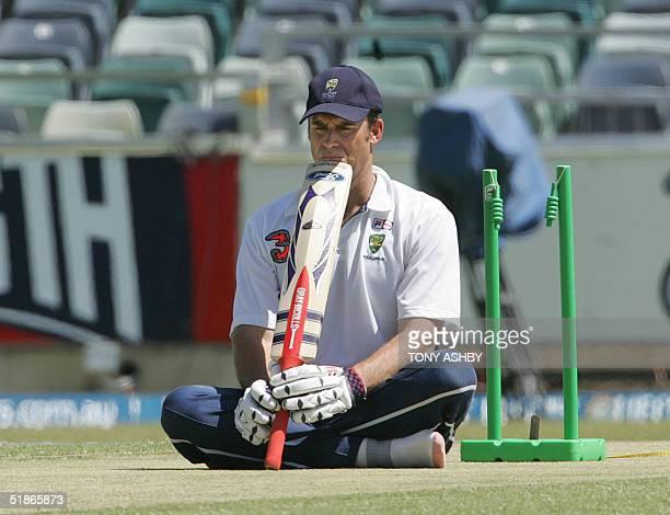 Australian opening batsman Matthew Hayden performs his meditating ritual on the wicket at the Western Australian Cricket Association ground after...