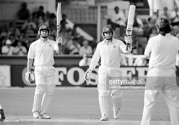 Australian opening batsmen Mark Taylor and Geoff Marsh acknowledge the applause as their opening partnership reaches 300 at the end of the first day...