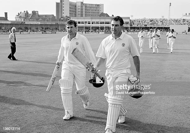 Australian opening batsmen Mark Taylor and Geoff Marsh acknowledge the applause as they leave the field with an undefeated partnership of 301 runs on...