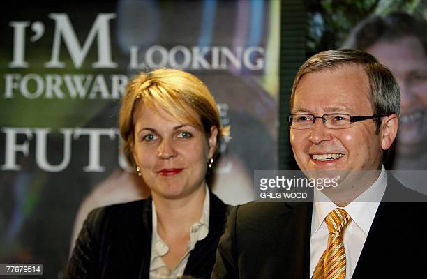 Australian Opposition Leader Kevin Rudd watched by Shadow Minister for Housing Tanya Plibersek smiles at a press conference during a visit to the...