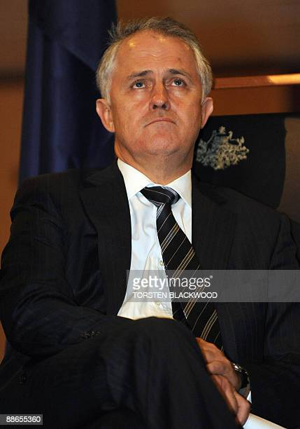 Australian opposition leader Malcolm Turnbull watches on during an official reception at Parliament House in Canberra on June 24 2009 Turnbull came...