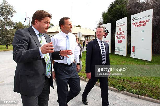 Australian Opposition Leader Tony Abbott and Manager of Opposition Business in the House Chris Pyne arrive at Penrice Soda factory on September 3...