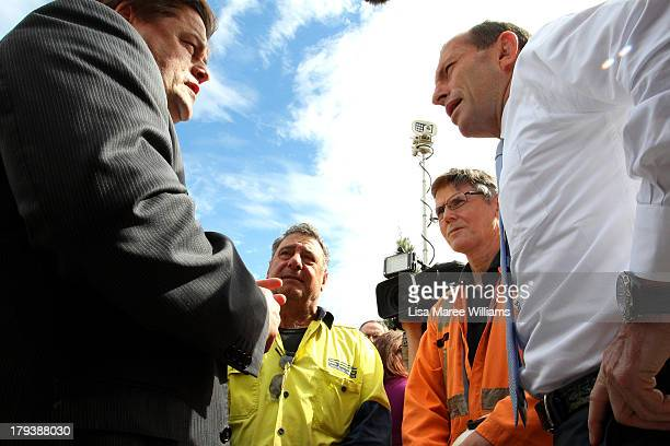 Australian Opposition Leader Tony Abbott and Penrice CEO Guy Roberts speak to workers at Penrice Holdings on September 3 2013 in Adelaide Australia...