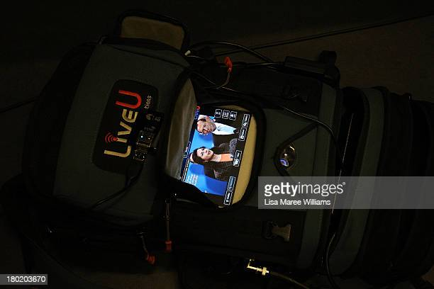 Australian Opposition Leader Tony Abbott and Senator Connie Fierravanti Wells are seen on a monitor during a press conference at Headspace on August...
