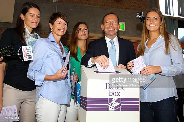 Australian Opposition Leader Tony Abbott casts his vote in the Federal Election flanked by his daughters Bridget Frances and Louise and his wife...