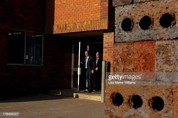 Australian Opposition Leader Tony Abbott concludes a tour of the Austral Brick factory and prepares to face the media on September 3 2013 in...