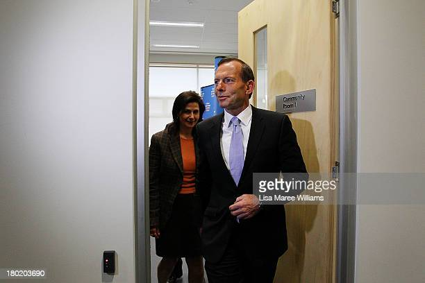 Australian Opposition Leader Tony Abbott leaves a press conference at Headspace on August 30 2013 in Melbourne Australia Tony Abbott announced that...