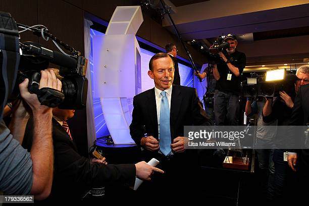 Australian Opposition Leader, Tony Abbott leaves the stage following his address to the media at the National Press Club on September 2, 2013 in...
