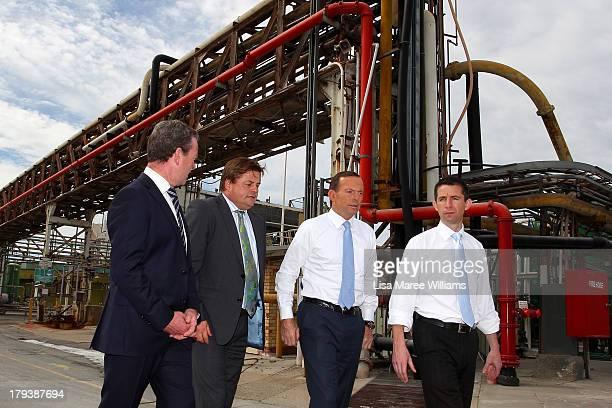 Australian Opposition Leader Tony Abbott looks on at Penrice Soda Factory on September 3 2013 in Adelaide Australia In the 2010 election the...