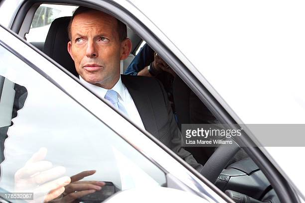Australian Opposition Leader Tony Abbott looks out from the driver's seat of a locally built Toyota car on August 30 2013 in Melbourne Australia...