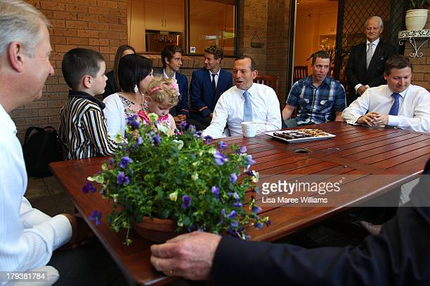 Australian Opposition Leader Tony Abbott meets with a family to discuss policies on September 3 2013 in Adelaide Australia In the 2010 election the...