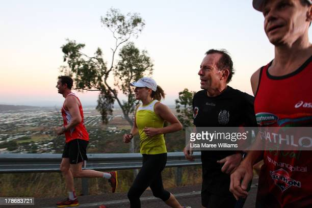 Australian Opposition Leader Tony Abbott runs up Castle Hill with security staff on August 31 2013 in Townsville Australia Australian voters will...