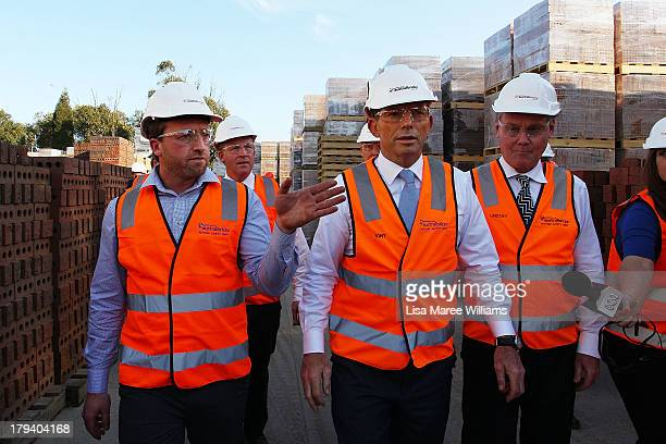 Australian Opposition Leader Tony Abbott with David Robertson and Lindsay Patridge tours the Austral Brick factory on September 3 2013 in Launceston...