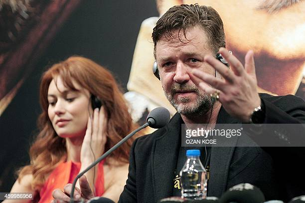 Australian Oscarwinning actor Russell Crowe talks to the press as he sits next to Olga Kurylenko at Turkish the premiere of 'The Water Diviner' on...