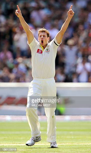 Australian paceman James Pattinson celebrates dismissing Indian batsman Virender Sehwag on the second day of the first Test match between Australian...
