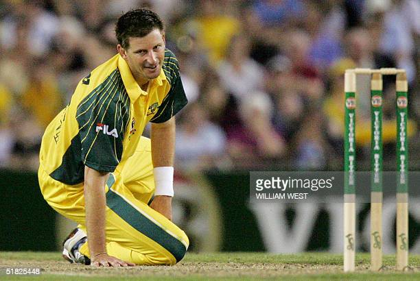 Australian paceman Michael Kasprowicz despairs as he carted for 22 runs in his final over by the New Zealand batsman during their oneday match being...