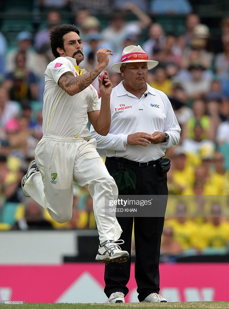 Australian paceman Mitchell Johnson bowls to England's batsman James Anderson (not seen in picture) on the first day of the fifth Ashes cricket Test at the Sydney Cricket Ground on January 3, 2014. AFP PHOTO / Saeed KHAN USE