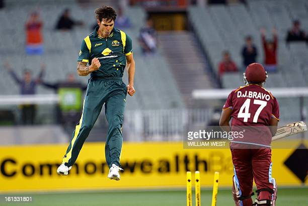 Australian paceman Mitchell Johnson leaps in the air after bowling West Indies batsman Dwayne Bravo in their oneday cricket international played at...
