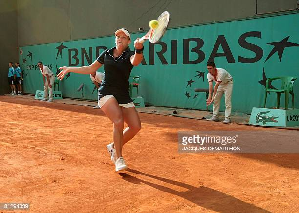 Australian palyer Casei Dellacqua returns a ball to Spanish player Carla Suarez Navarro during a match with during the third round of the French...