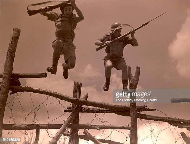 Australian parachute troops train during an assault course in Richmond Sydney 26 November 1943 SMH Picture by FREDERICK HALMARICK