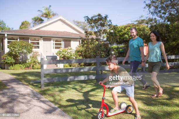 australian parents and son go walking in suburban sydney - cultures stock pictures, royalty-free photos & images