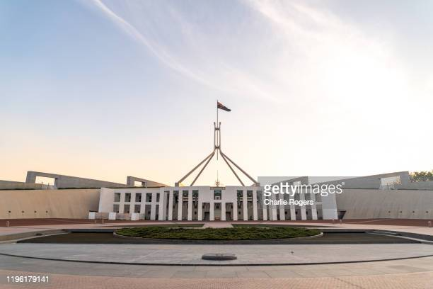 australian parliament house exterior at sunset - australian politics stock pictures, royalty-free photos & images