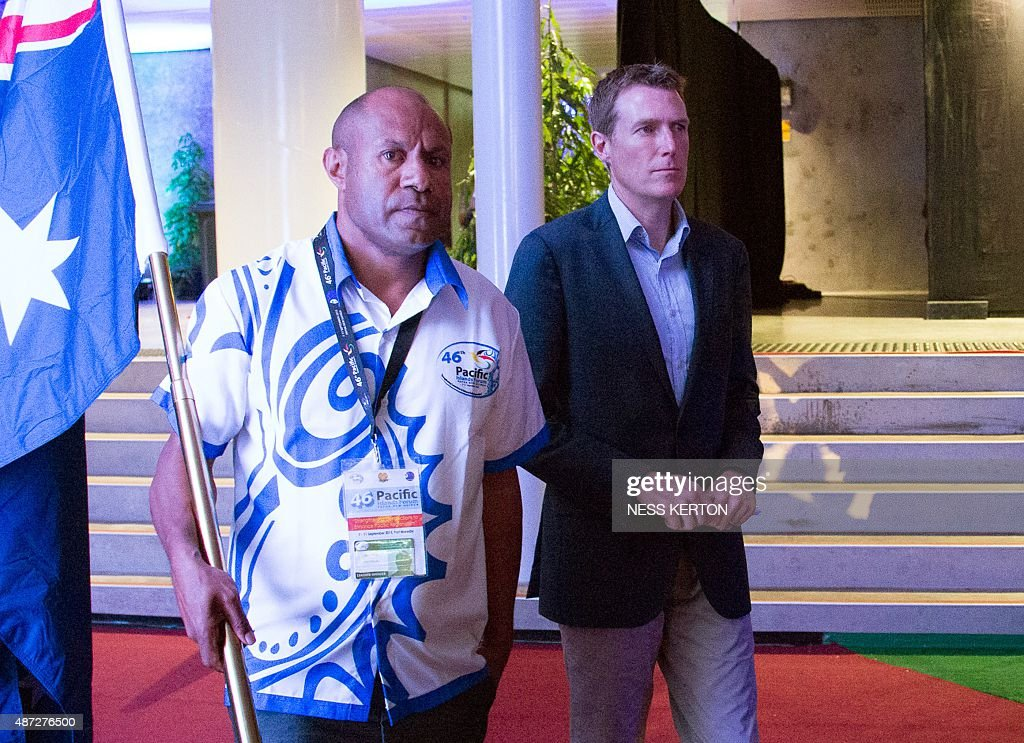 Australian parliamentary secretary Christian Potter (R) arrives for the official opening of the 46th Pacific Islands Forum (PIF) in Port Moresby on September 8, 2015. The 16-nation grouping consists mainly of small island nations, together with Australia and New Zealand, with the two developed nations being accused of dragging their feet on climate change. AFP PHOTO/Ness KERTON