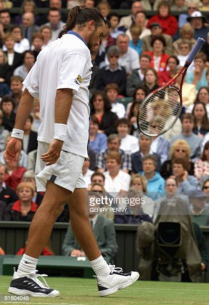 Australian Patrick Rafter tosses his racket after loosing a point during his Singles semifinal match at the Wimbledon tennis tournament against US...