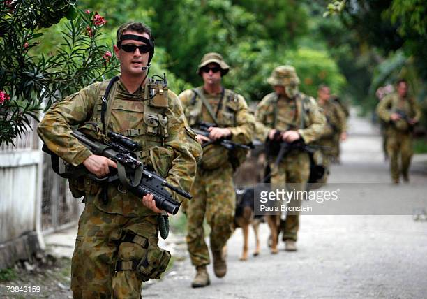 Australian peacekeepers patrol in the capitol city after the polls closed April 9 2007 in Dili East Timor Voters cast their ballots today as eight...