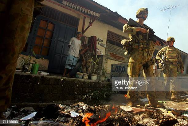 Australian peacekeeping soldiers patrol near a fire at a house torched by alleged gang violence June 7 2006 in Dili East Timor Australia is asking...