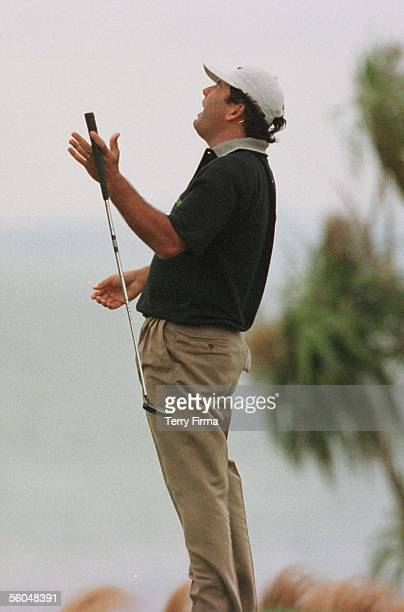 Australian Peter O'Malley cant believe his luck, as his putt goes wide at the 16th, on day two of the World Cup Of Golf, played at the Gulf Harbour...