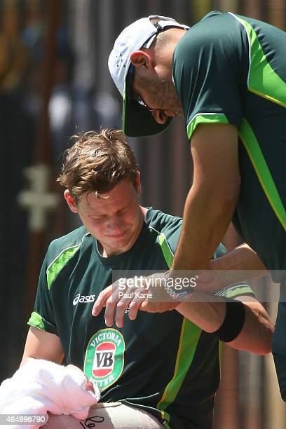 Australian physio Alex Kountouris checks the left hand of Steven Smith of Australia during an Australian nets session at the WACA on March 3 2015 in...