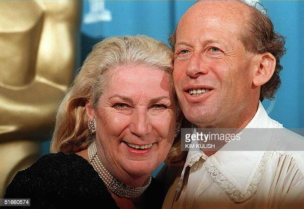 Australian pianist David Helfgott and his wife Gillian pose for photographers during the 69th Academy Awards ceremony at the Shrine Auditorium in Los...