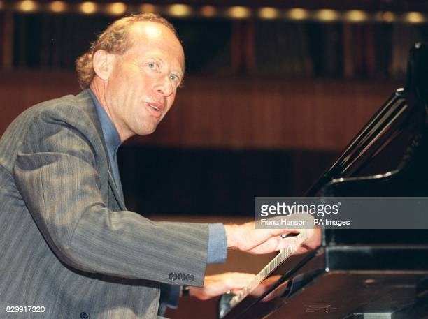 Australian pianist David Helfgott subject of the awardwinning film Shine rehearses at the Royal Festival Hall before making his UK debut tomorrow...