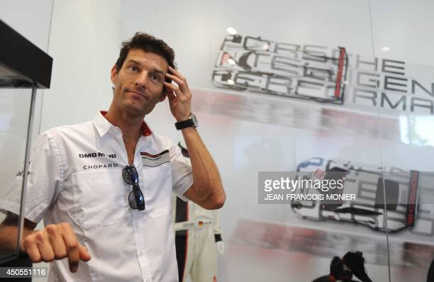 Australian pilot Mark Webber, driving a Porsche 911 Hybrid N20, poses after a press conference on June 13, 2014 in Le Mans, western France, on the...