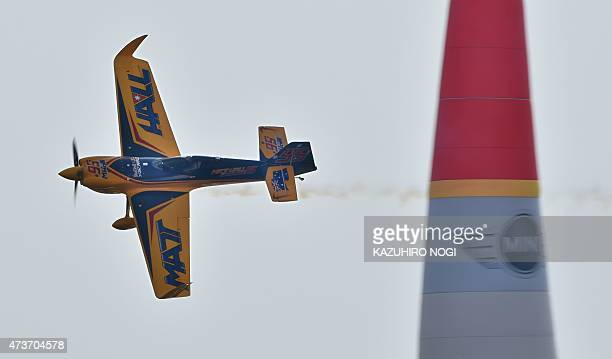 Australian pilot Matt Hall of Matt Hall Racing flies his airplane during the round of four Master Class final competitions at the Red Bull Air Race...