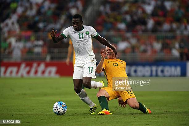 Australian player Aaron Mooy competes with Saudi Abdulamlek Al Khaibri during the match between Saudi Arabia and Australia for the FIFA World Cup...