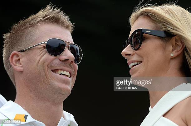 Australian player David Warner smiles with his partner during a New Year's Day reception hosted by the Australian Prime Minister Tony Abbott for...