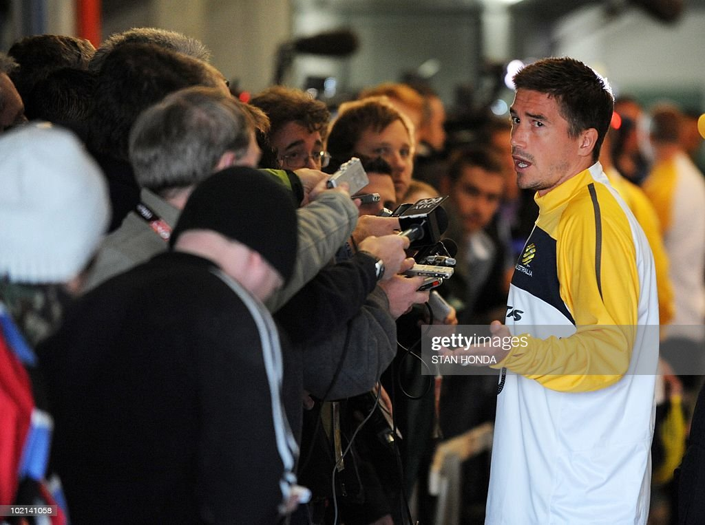 Australian player Harry Kewell (R) speaks to the media before a team training session at Ruimsig Stadium in Roodepoort on June 16, 2010 during the 2010 World Cup football tournament. AFP PHOTO/Stan Honda