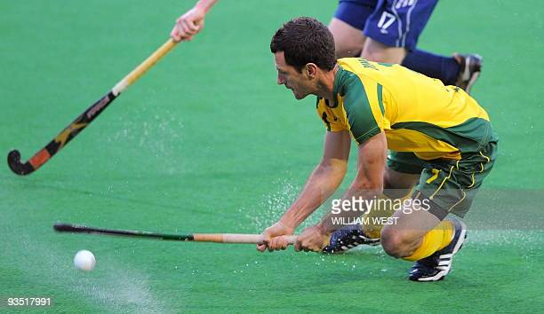 Australian player Jamie Dwyer attempts a shot on the English goal during their Champions Trophy field hockey match in Melbourne on December 1, 2009....