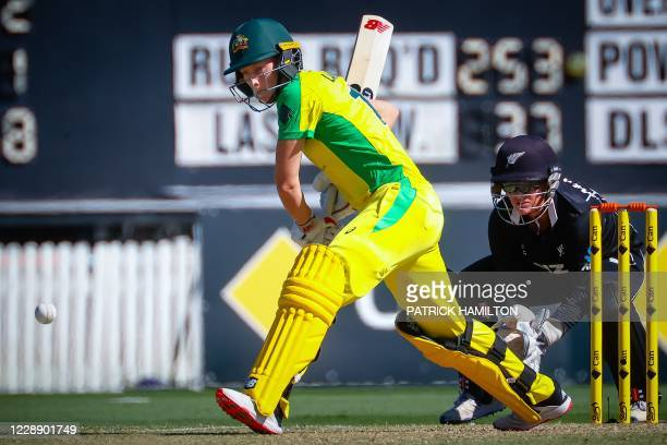 Australian player Meg Lanning eyes the ball to play a shot during the second one-day international cricket match between Australia and New Zealand at...