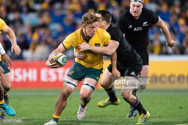 Australian player Michael Hooper tries to break the tackle of New Zealand player Ben Smith at the Bledisloe Cup rugby test match between Australia...